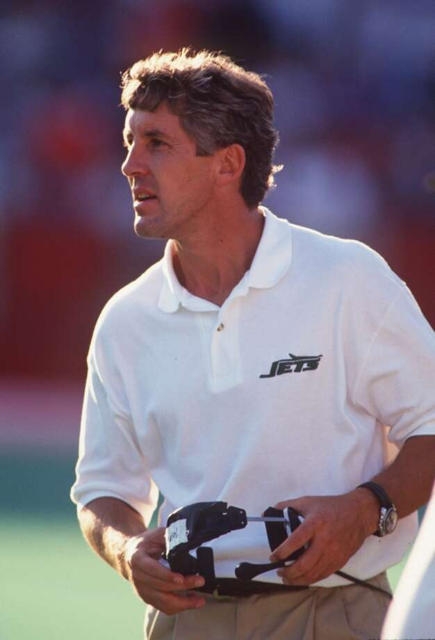After 10 years climbing through the college ranks as a secondary coach and defensive coordinator, the Buffalo Bills hired Pete Caroll in 1984 as their defensive backs coach. The Minnesota Vikings hired him in the same role the next year, and he helped lead the Vikings to three-straight playoff appearances. In 1990, he took a job with the New York Jets (above) as their defensive coordinator, and after four seasons was promoted to head coach. Photo: Rick Stewart, Getty Images