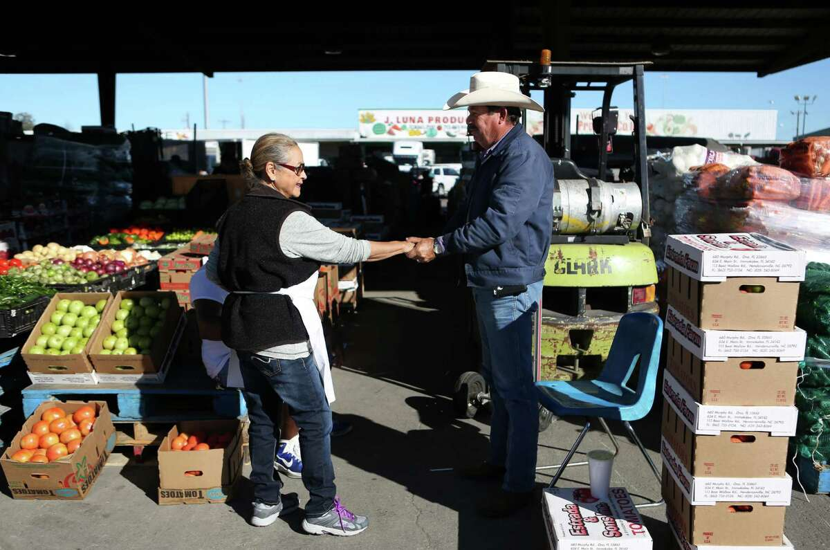 """(Left to right) Irma Galvan, owner of Irma's Restaurant in downtown Houston, is greeted by vendor Gregorio Gutierrez Beltran, aka the """"Cowboy"""", while she shops at fresh produce market on Airline Drive on Tuesday, Jan. 27, 2015, in Houston. It is easier to find items for Hispanic food since demand in Hispanic restaurants and appetite for Hispanic food has risen. ( Mayra Beltran / Houston Chronicle )"""