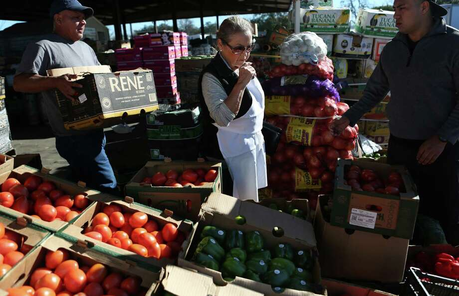 (Center) Irma Galvan, owner of Irma's, shops at fresh produce market on Airline Drive on Tuesday, Jan. 27, 2015, in Houston. It is easier to find items for Hispanic food since demand in Hispanic restaurants and appetite for Hispanic food has risen. ( Mayra Beltran / Houston Chronicle ) Photo: Mayra Beltran, Staff / © 2015 Houston Chronicle