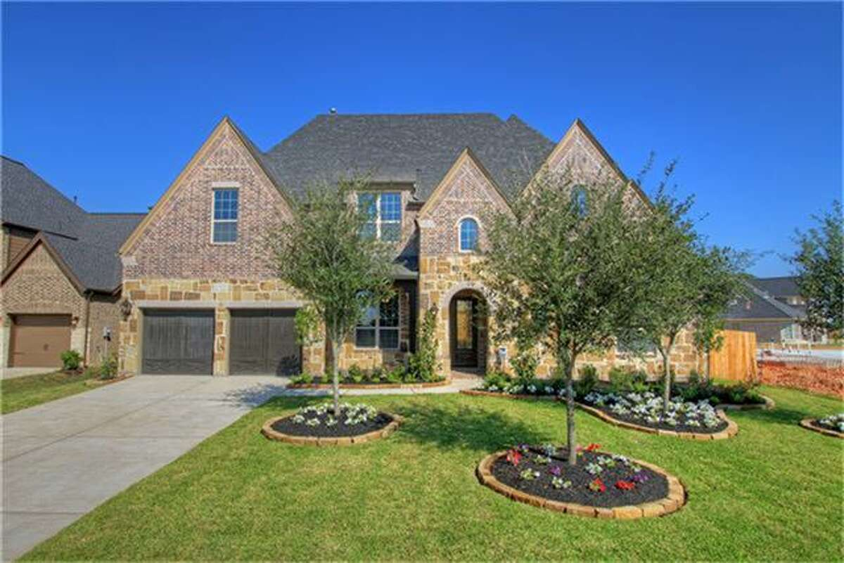 This five-bedroom Katy home, built in 2014 but never lived in, features a media room, a study and a game room with a wet bar: 4,313 square feet.