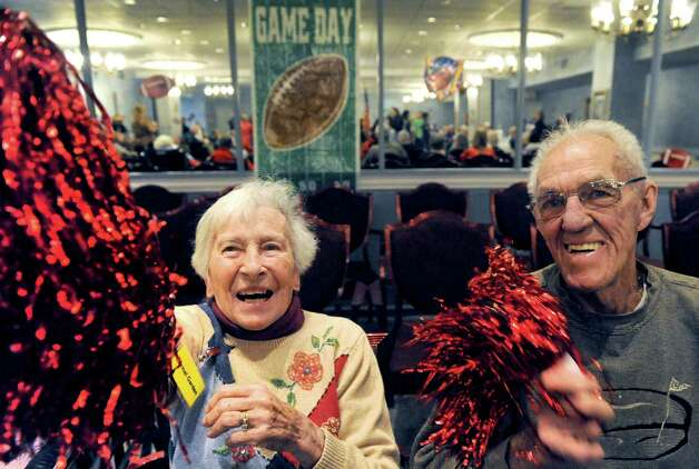 Joan and John Kaminski cheer on the 12th Man team during the Wheelchair Super Bowl XII at Teresian House on Friday Jan. 30, 2015 in Albany, N.Y. (Michael P. Farrell/Times Union) Photo: Michael P. Farrell / 00030409A