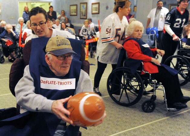 John Flaherty of the Deflate-triots rolls back a kickoff pushed by Jennifer Polak during the Wheelchair Super Bowl XII at Teresian House on Friday, Jan. 30, 2015, in Albany, N.Y. The Deflate-triots defeated the 12th man team 56-48.(Michael P. Farrell/Times Union) Photo: Michael P. Farrell / 00030409A