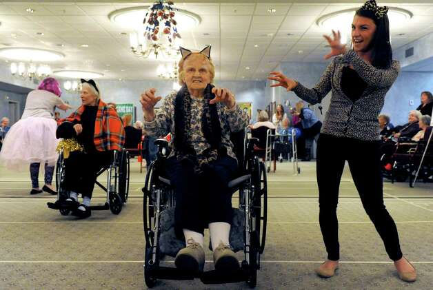 Catherine Shaffer, center, and Briana Ambrose take part in the halftime show during the Wheelchair Super Bowl XII at Teresian House on Friday, Jan. 30, 2015, in Albany, N.Y. The Deflate-triots defeated the 12th man team 56-48.(Michael P. Farrell/Times Union) Photo: Michael P. Farrell / 00030409A