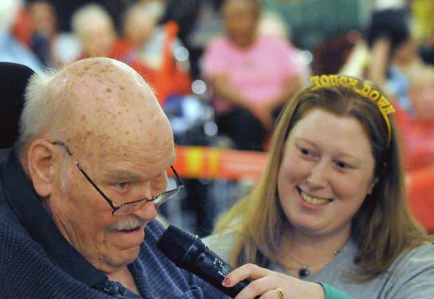 John Cunnigham sing the national anthem  as Melissa Morgan holds the microphone during the Wheelchair Super Bowl XII at Teresian House on Friday Jan. 30, 2015, in Albany, N.Y. The Deflate-triots defeated the 12th man team 56-48.(Michael P. Farrell/Times Union) Photo: Michael P. Farrell / 00030409A