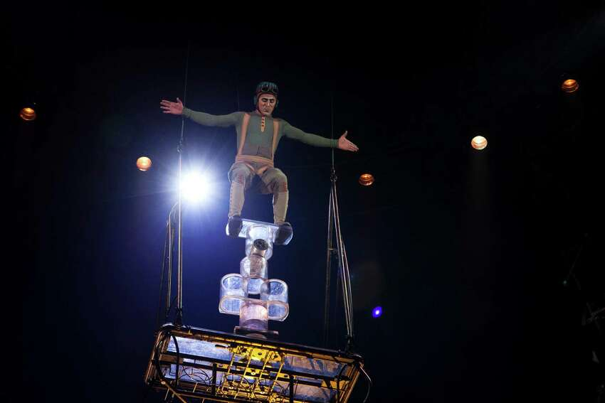 Suspended into the air, an aviator character performs roll bola at Cirque du Soleil's new show,