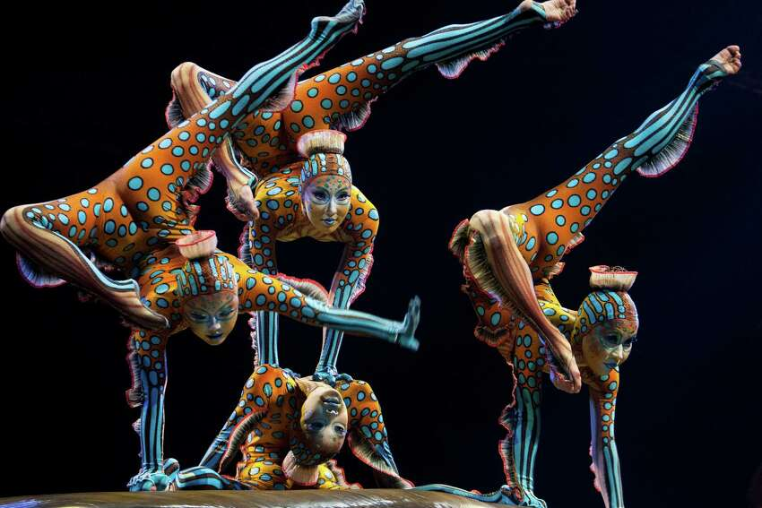 Four contortion artists hold their pose during Cirque du Soleil's new show,