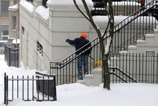 Gary Brizzie clears the steps of snow at the New York State Court of Appeals on Friday Jan. 30, 2015 in Albany, N.Y. (Michael P. Farrell/Times Union) Photo: Michael P. Farrell