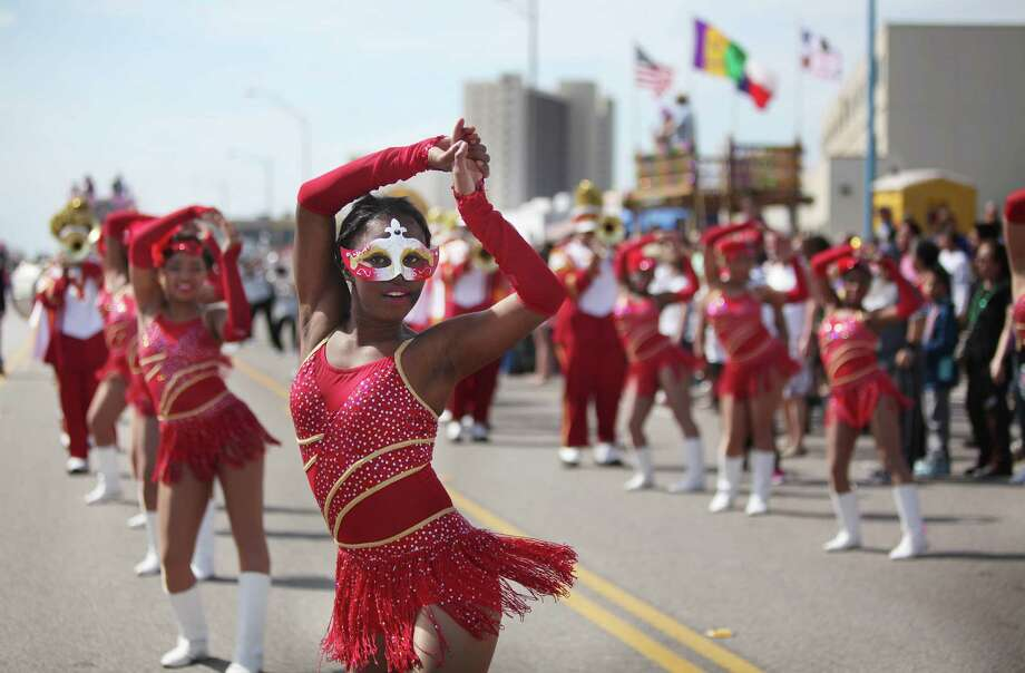 Galveston's Mardi Gras festivities, expected to draw more than 350,000 people to the island, are Feb. 6-17. Among the highlights: the Mystic Krewe of Aquarius Kick-off Parade on Saturday. Photo: Mayra Beltran, Staff / © 2014 Houston Chronicle