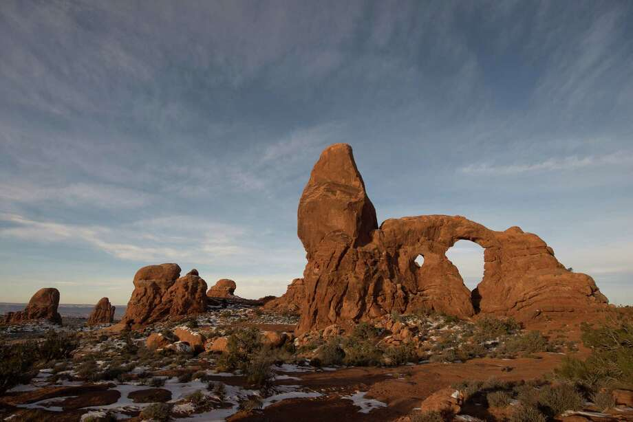 Easy footpaths connect Turret Arch with the North and South Windows in the surprise that is Arches National Park. These two arches will join one day. / ONLINE_YES