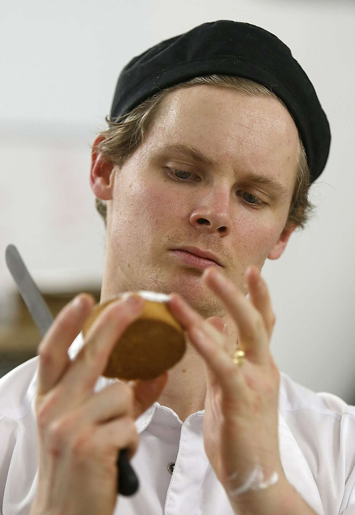 Head chef Ry Stephen works on a passionfruit brownie tart at Mr. Holmes Bakehouse in San Francisco, Calif., on Tuesday, January 27, 2015.