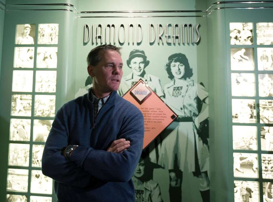 Former Houston Astros player Craig Biggio visits an exhibit on women in baseball during his orientation visit at the Baseball Hall of Fame on Friday, Jan. 30, 2015, in Cooperstown, N.Y. Biggio will be inducted to the Hall in July. (AP Photo/Mike Groll) Photo: Mike Groll, Associated Press