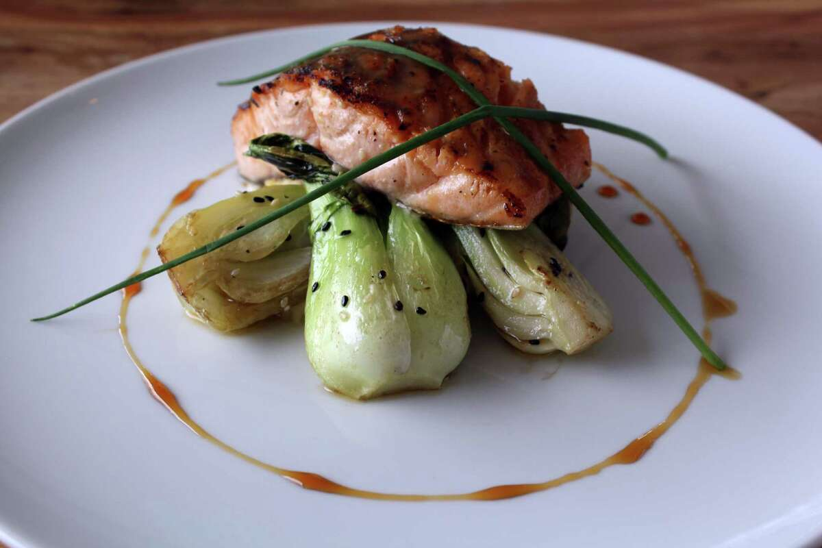 Miso-gazed salmon at Silo Terrace Oyster Bar is served with wasabi whipped potatoes, sesame bok choy and a sweet soy reduction.