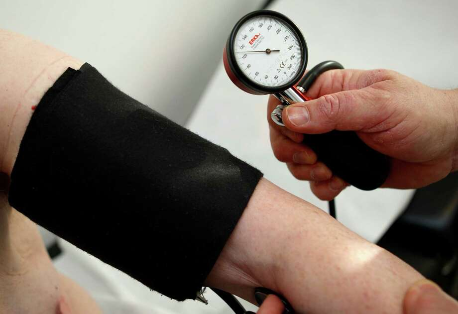 """The U.S. Preventive Services Task Force says that between 15 percent and 30 percent of people who are told they have high blood pressure after an in-office """"cuff on arm"""" test do not experience hypertension in their day-to-day life. As a result, people are given unnecessary medication. Photo: Thomas Kienzle, STF / AP"""