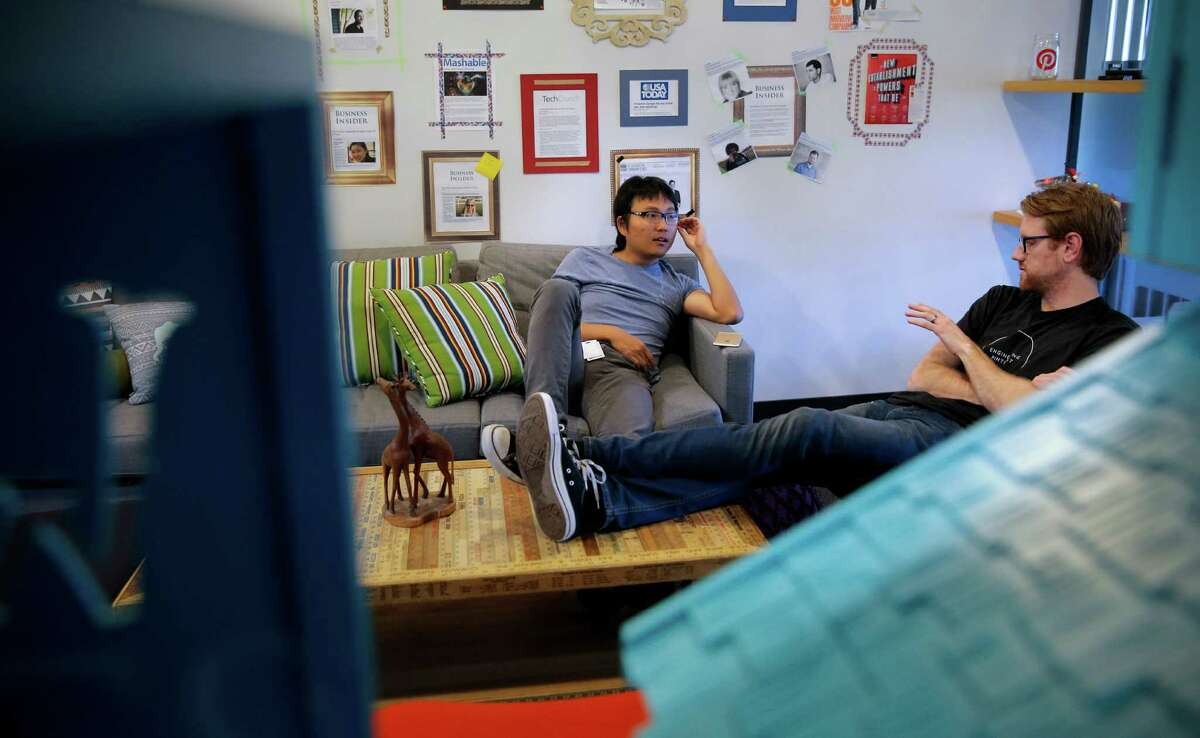 Engineers Christine Cassis (left) and Everett Katigbak talk shop at the headquarters of Pinterest in San Francisco.