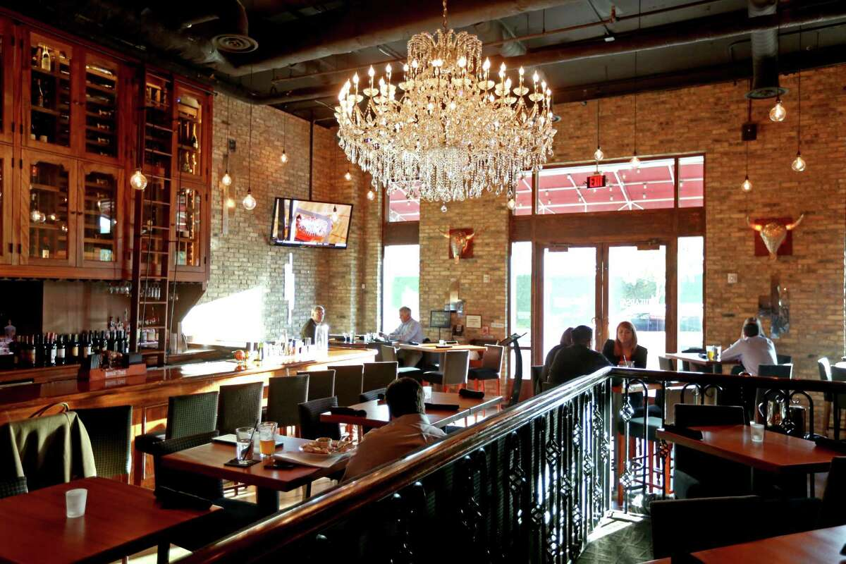 Hearsay Gastro Lounge 218 Travis St Houston, TX 77002   Happy hours: 4 to 7 p.m. Deals for: Burgers, sandwiches, salads and wine.