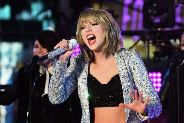 "(FILES) In this December 31, 2014 file photo, US singer Taylor Swift performs during New Years Eve celebrations at the Times Square in New York. Taylor Swift on January 27, 2015 scoffed at a hacker who took over her social media accounts and threatened to release nude pictures, with the pop star saying none existed. The singer's Twitter and Instagram accounts were briefly seized by at least one hacker who vowed to release naked pictures of Swift if supporters paid enough in the form of the virtual currency bitcoin. ""Any hackers saying they have 'nudes'?"" Swift wrote after retaking control of her Twitter account. ""Psssh you'd love that wouldn't you! Have fun photoshopping cause you got NOTHING."" AFP PHOTO/JEWEL SAMAD / FILESJEWEL SAMAD/AFP/Getty Images"