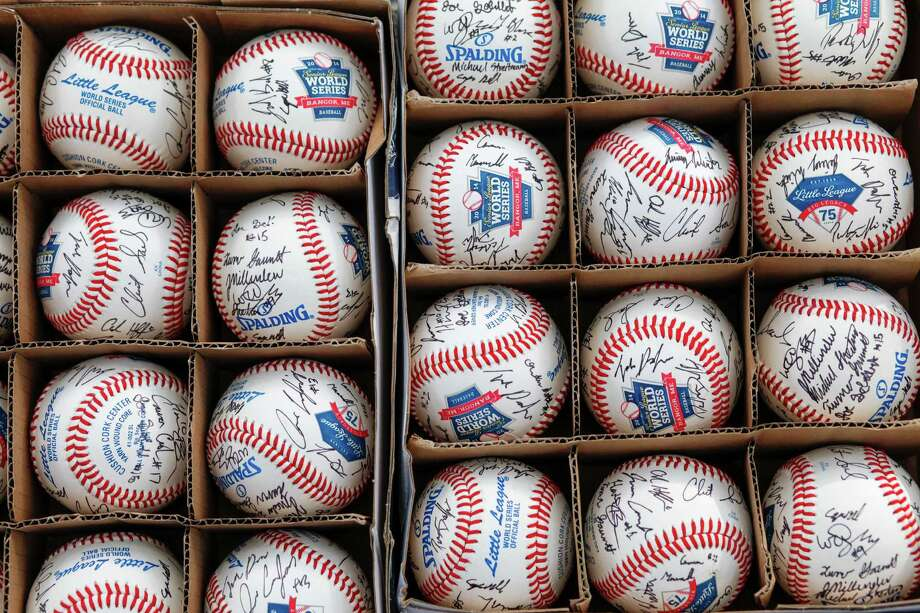 Baseballs signed by the West University Little League team before they participate in a parade in Houston celebrating their Senior's world championship win in 2014. Photo: Eric Kayne / Eric Kayne