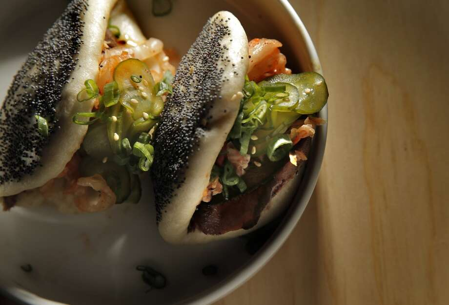 The beef tongue, kimchi, cucumber, poppy seed steam bun ($12) served on opening night at Liholiho Yacht Club, San Francisco. Photo: Carlos Avila Gonzalez, The Chronicle