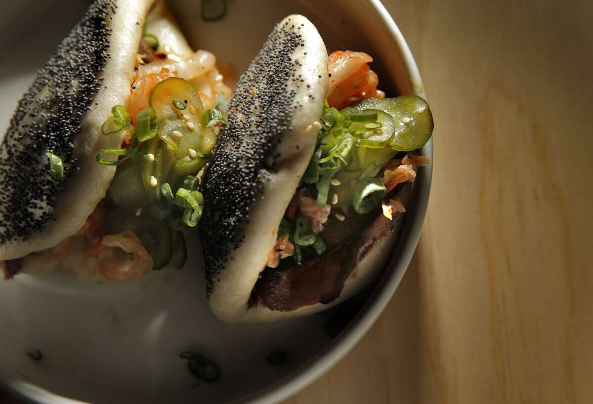 The beef tongue, kimchi, cucumber, poppy seed steam bun ($12) served on opening night at Liholiho Yacht Club, San Francisco.