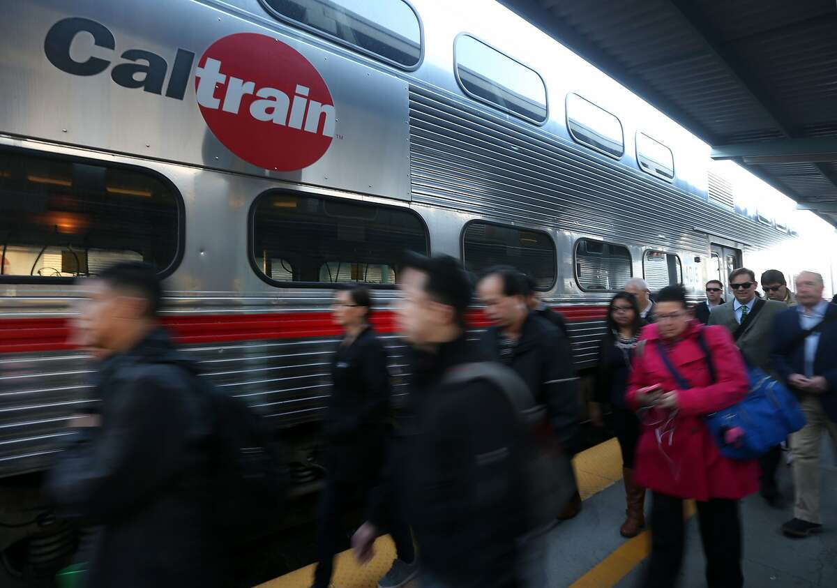 Commuters arrive at the Caltrain station on Fourth and King streets in San Francisco, Calif. on Wednesday, Jan. 28, 2015.