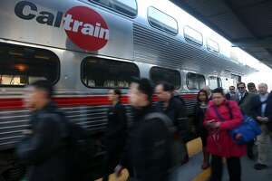 Commuters arrive at the Caltrain station on Fourth and King streets in San Francisco, Calif. on Wednesday, Jan. 28, 2015. Ridership is at an all-time high with trains frequently filled beyond their capacity.