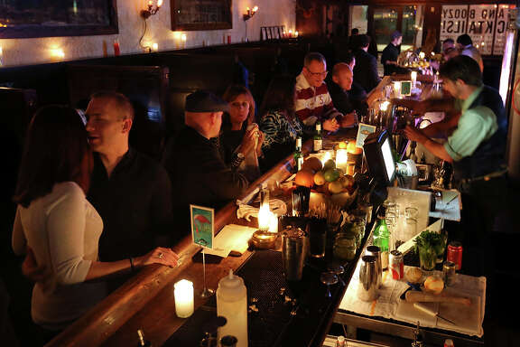 Patrons enjoy drinks during The Esquire Tavern 80th birthday celebration, which coincided with the anniversary of the end of Prohibition.