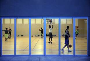 Josh Jackson (center) takes a shot during practice at Prolific Prep. Most players attend schools in Napa.