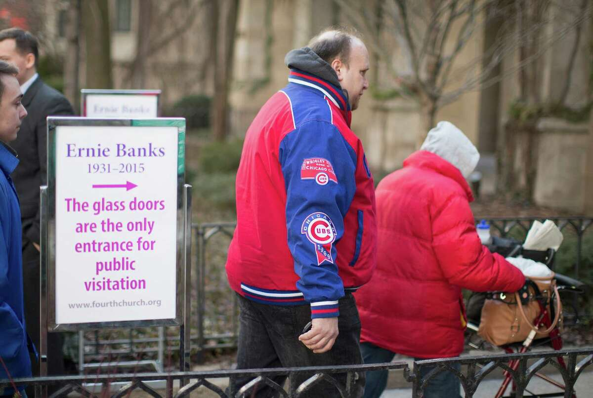 Chicago Cubs fans attend the visitation for former player Ernie Banks at the Fourth Presbyterian Church on January 30, 2015 in Chicago, Illinois.