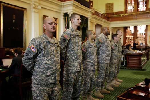 U.S. Army soldiers and reservist from the Brooke Army Medical Center Warrior Transition Battalion stand in front of the chambers as they are honored by the Texas State Senate, Jan. 24, 2011. The Senate passed a resolution honoring the soldiers who are from left, Maj. John J. Ploch, of La Vernia, Sgt. Chris Goebel, of New Hope, Minnesota, Sgt. Juan Carrion of The Bronx, NY, Staff Sgt. Frank Lamar, Grand Rapid, Michigan, Pfc. Kevin Macari of Mesa, Arizona, and Staff Sgt. Richard Groff, of New Braunfels. Photo: Jerry Lara /San Antonio Express-News / glara@express-news.net