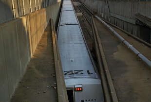 A BART train in Oakland heads toward the Transbay Tube, where passengers are often stuck during service delays.