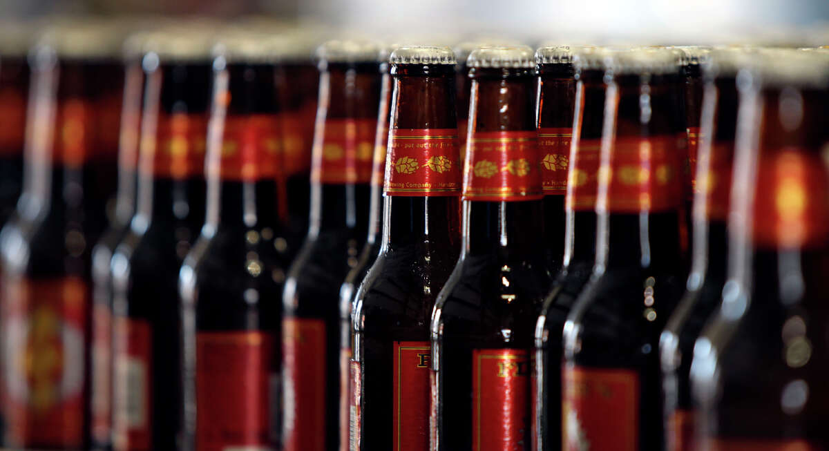 Bottles of Real Ale Brewing Co. beer are lined up and ready for packaging.