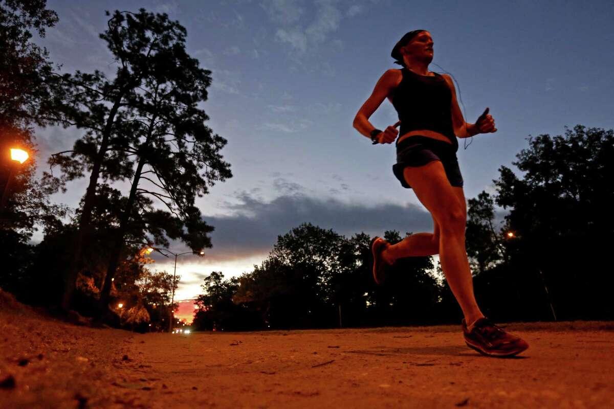 An early morning runner on the Seymour Lieberman Exertrail along Memorial Drive Friday, Nov. 7, 2014, in Houston, Texas. ( Gary Coronado / Houston Chronicle )