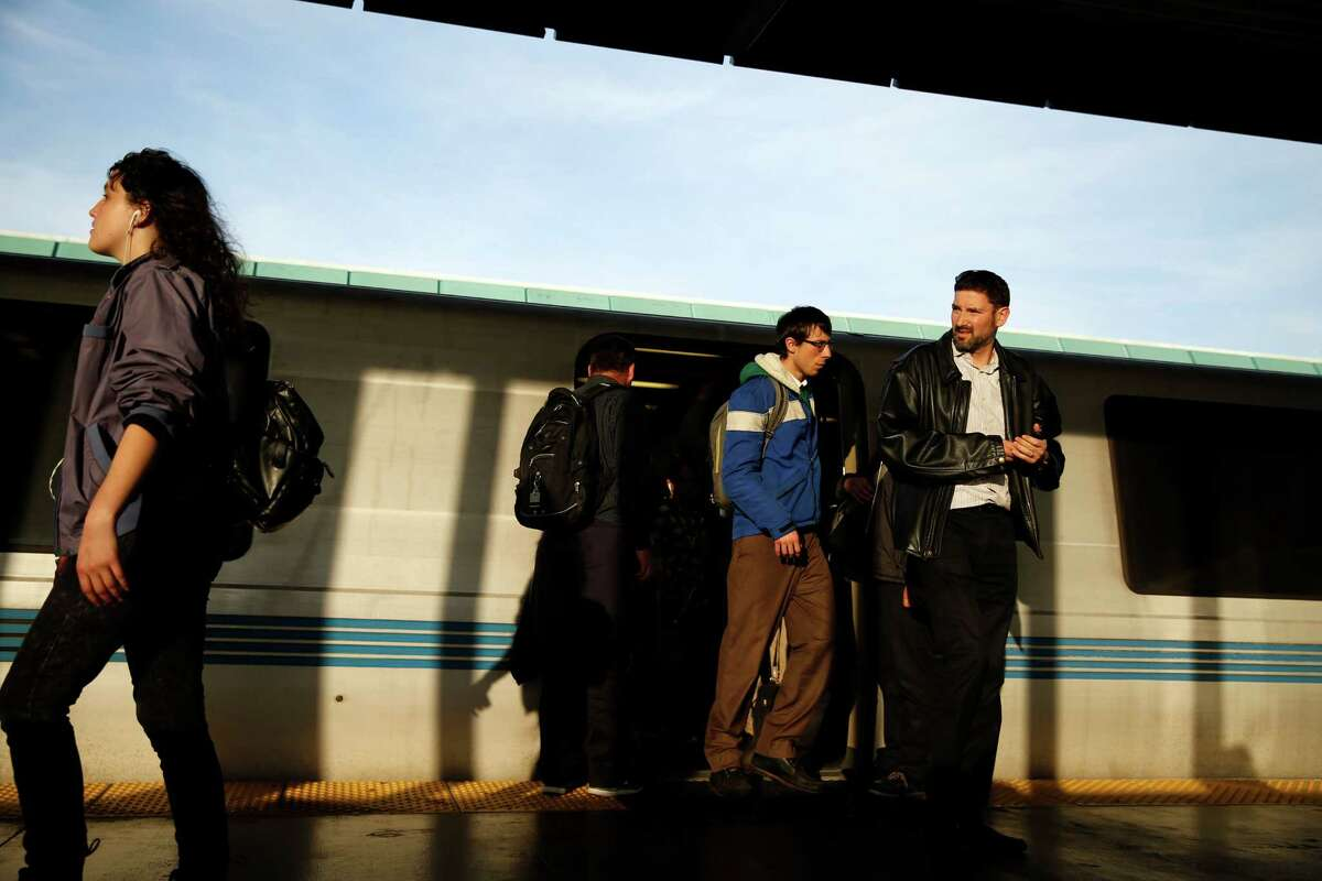 Commuters disembark from a BART train from San Francisco at the West Oakland station in Oakland, Calif., on Wednesday, January 28, 2015.