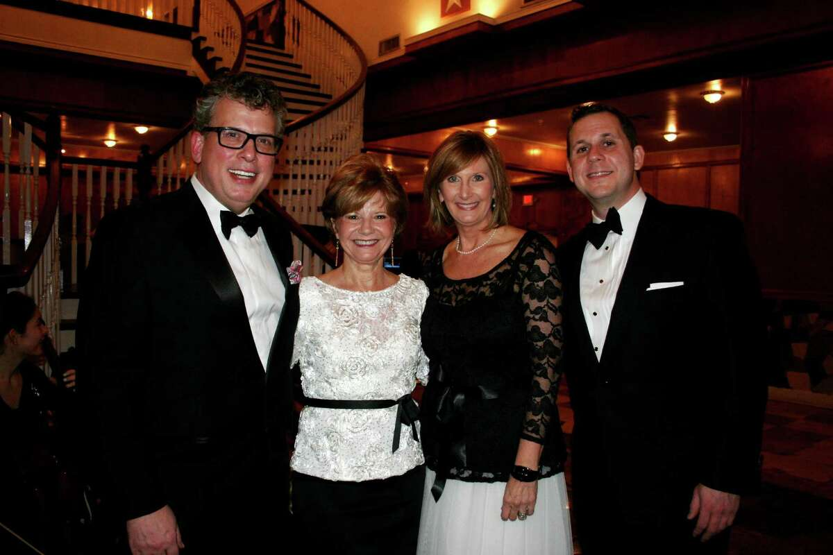 From left, Billy Stritch, honoree at the 13th annual Founders' Ball, was greeted by Bridget Yeung and Donna Molho, the event co-chairs, and Chad Muska, executive director of the Sugar Land Cultural Arts Foundation. The evening was a tribute to Stritch, who has been a leading advocate for the restoration of Sugar Land Auditorium, where he first performed as a student at Lakeview Elementary School.
