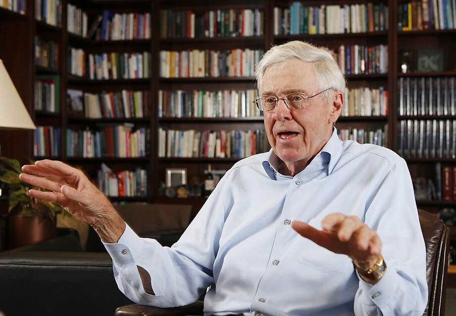 This photo taken May 22, 2012 shows Charles Koch in his office at Koch Industries in Wichita, Kansas, where Koch Industries manages 60,000 employees in 60 countries. The Kochs are demonized by Democrats, who lack a liberal equal to counter their weight, and not entirely understood by Republicans, who benefit from their seemingly limitless donations.  (AP Photo/The Wichita Eagle, Bo Rader) Photo: Bo Rader, Associated Press