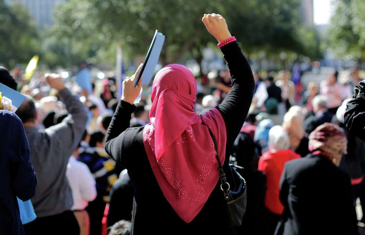 Participants cheer during a Texas Muslim Capitol Day rally, Thursday, Jan. 29, 2015, the seventh such event held in Austin, but the first met with angry protesters. (AP Photo/Eric Gay)