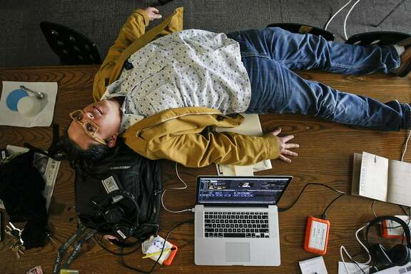 Chronicle photographer Mike Kepka takes a rest from tirelessly working on A Changing Mission, a year long project documenting gentrification in The Mission District in San Francisco.