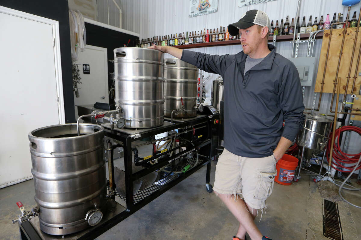 Seth Weatherly, owner and brewer of 5 Stones Artisan Brewery at 850 Schneider in Cibolo, stands beside some of his start-up brewing equipment.