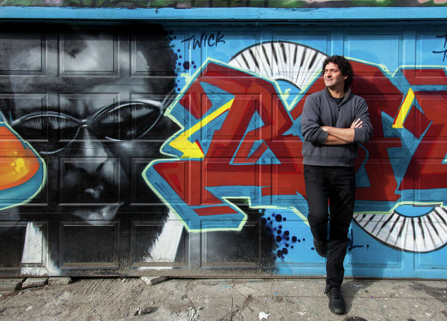 "Ken Schneider, in front of a favorite mural near where he works, will be at the Hot Stove festival with ""Havana Curveball."" Photo: Santiago Mejia / The Chronicle / ONLINE_YES"