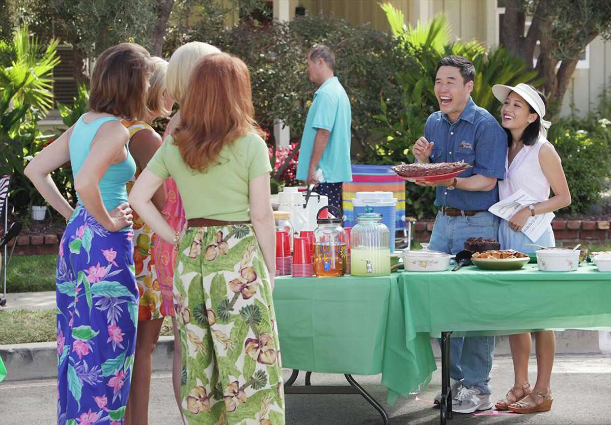 Constance Wu (right) and Randall Park play an Asian American couple who relocate their family from Washington, D.C., to Orlando in the mid-1990s in the sitcom