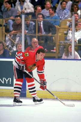 Doug Wilson, then a defenseman with the Chicago Blackhawks, warms up before a game against the Los Angeles Kings at the Great Western Forum during the 1989-90 season.