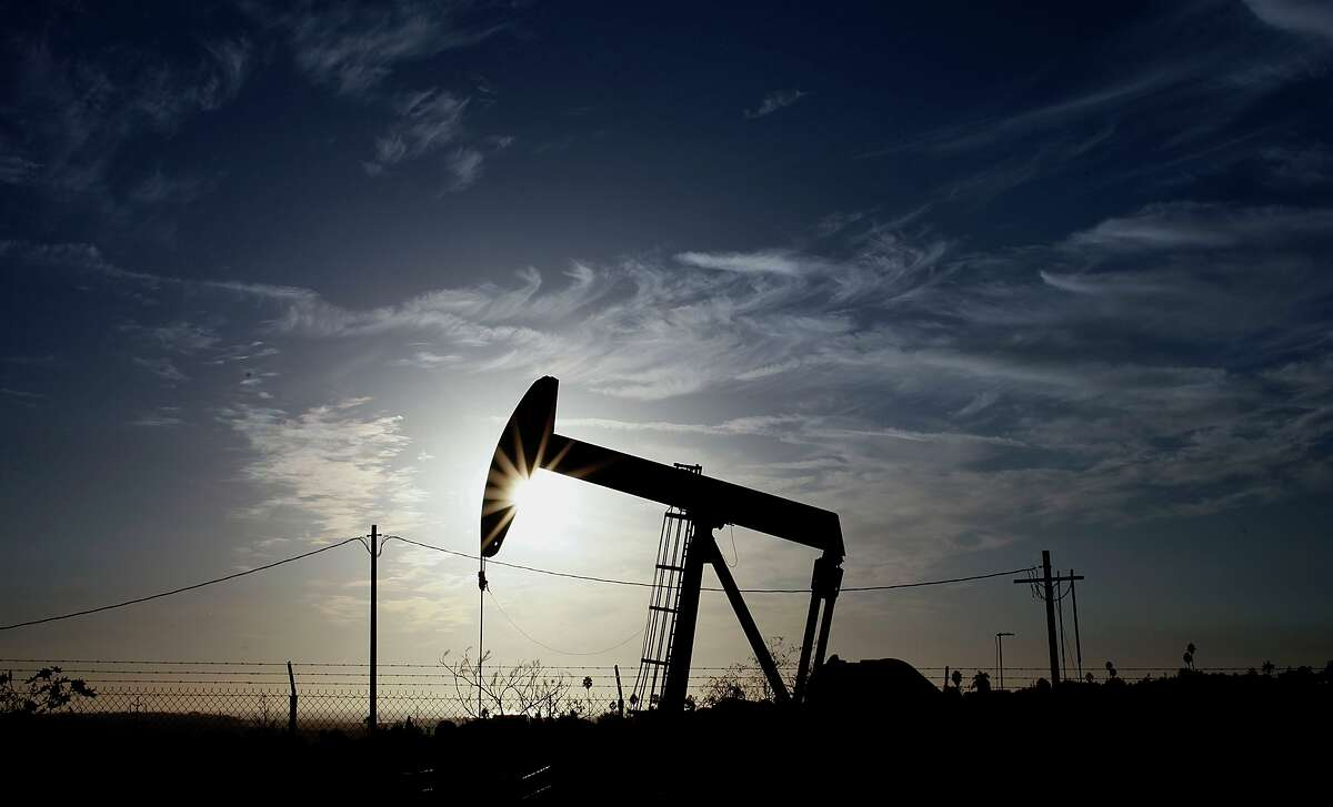 Long before the shale revolution, a vital contributor to U.S. oil production were stripper wells, small holes producing trickles of crude with the aid of iconic pumping machines known as nodding donkeys, such as the one shown here in 2012 in Los Angeles. With oil prices down 57 percent since June, these smallest of producers will be the first to succumb to the Great Oil Bust of 2015.