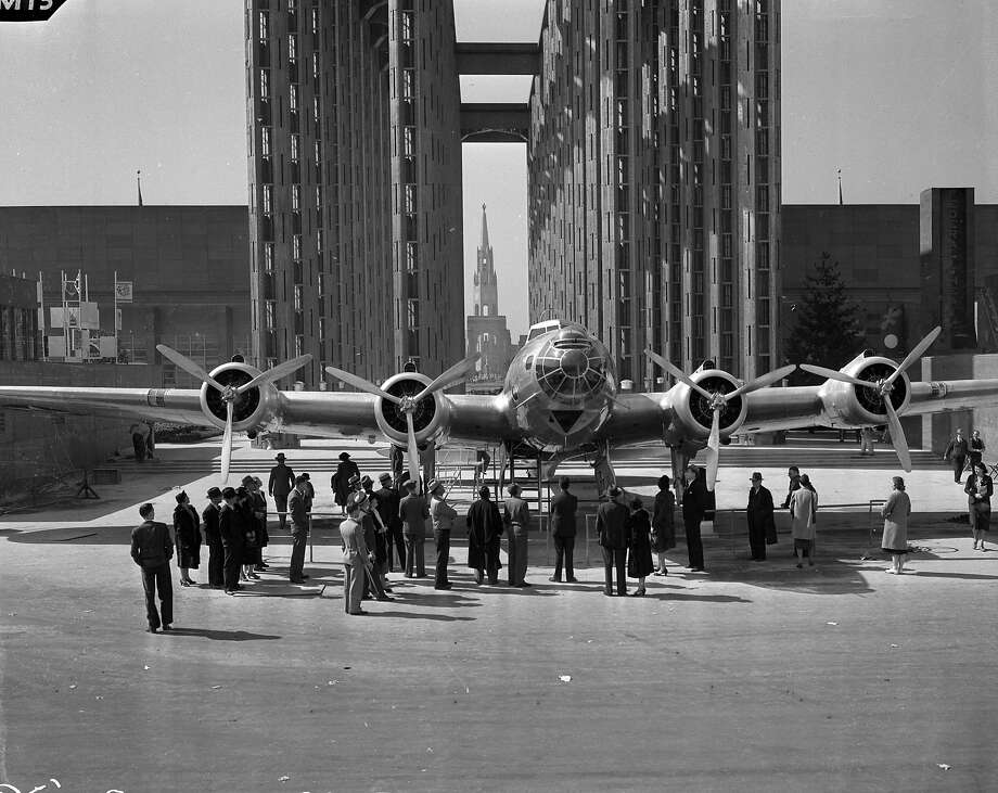 A prototype Boeing B-17 Flying Fortress attracts a crowd at The Golden Gate International Exposition (GGIE). The fair was held at San Francisco's Treasure Island, and celebrated the openings of the San Francisco-Oakland Bay Bridge (1936), and the Golden Gate Bridge (1937). The exposition was open from February 18, 1939, through October 29, 1939. The name of the photographer who made these images is unknown. Photo: Unknown, The Chronicle