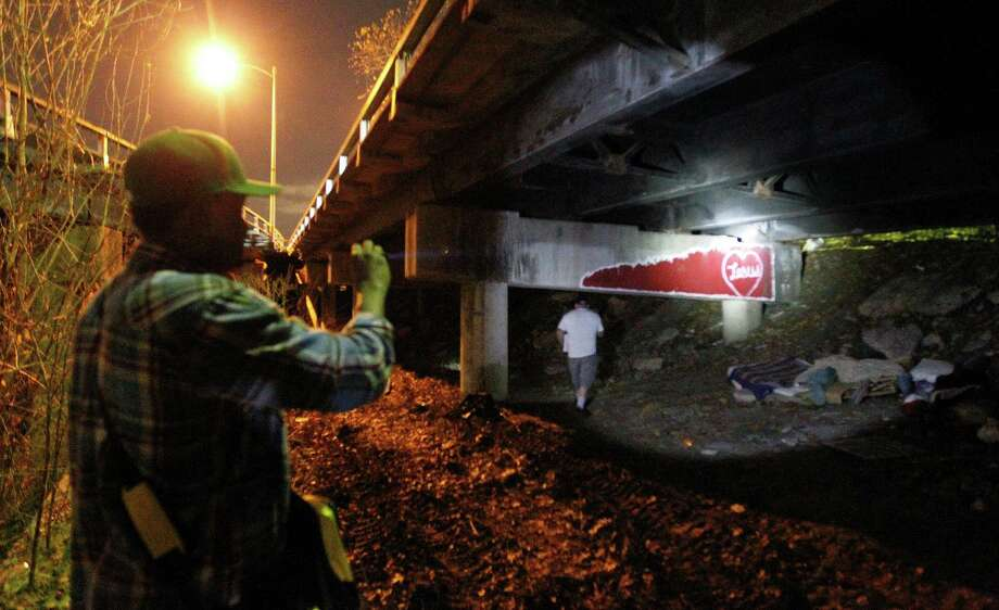 Social worker Harry Low shines his flashlight under the Elysian Street bridge looking for the homeless with a team of other social workers from the VA hospital walked downtown during the annual homeless census, Thursday, Jan. 29, 2015, in Houston. Photo: Karen Warren, Houston Chronicle / © 2015 Houston Chronicle