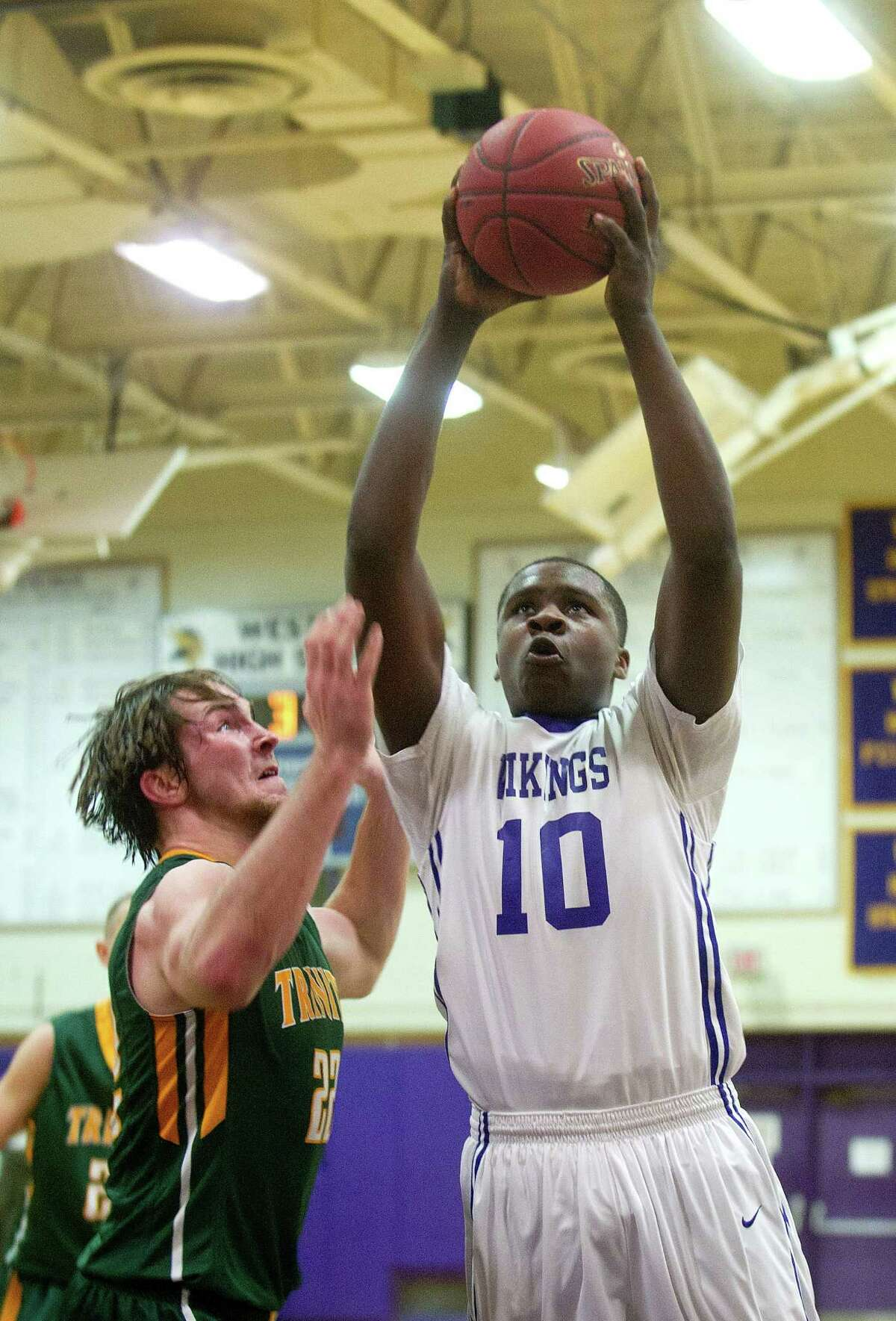 Westhilll's Tyrell Alexander takes a shot during Friday's basketball game against Trinity Catholic at Westhill High School on January 30, 2015.