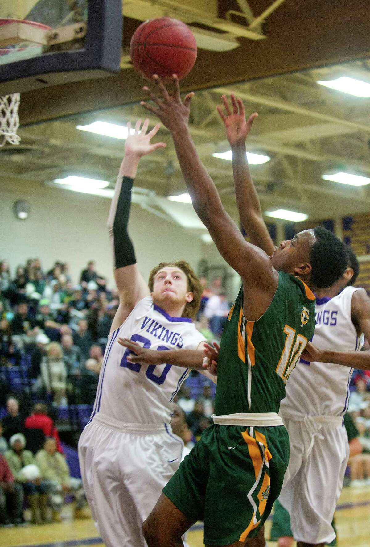 Trinity Catholic's Tyrell St. John takes a shot during Friday's basketball game at Westhill High School on January 30, 2015.