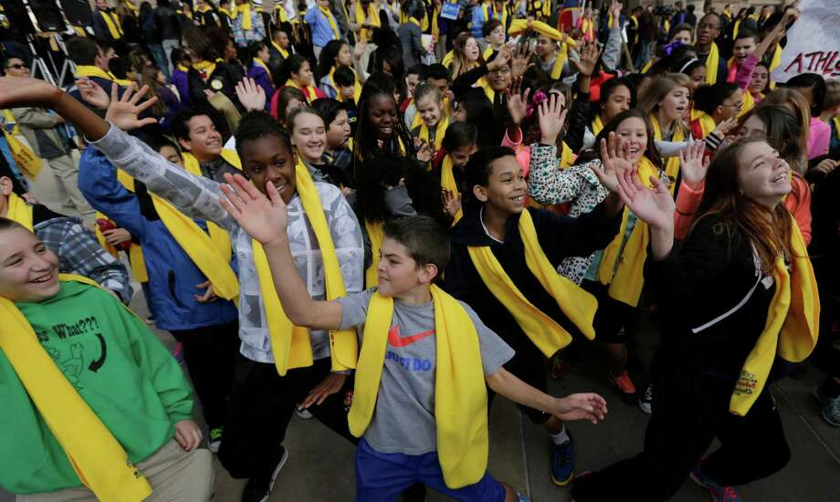 A flash dance by students was part of a school choice rally Friday in front of the Texas Capitol in Austin. Photo: Eric Gay, STF / AP