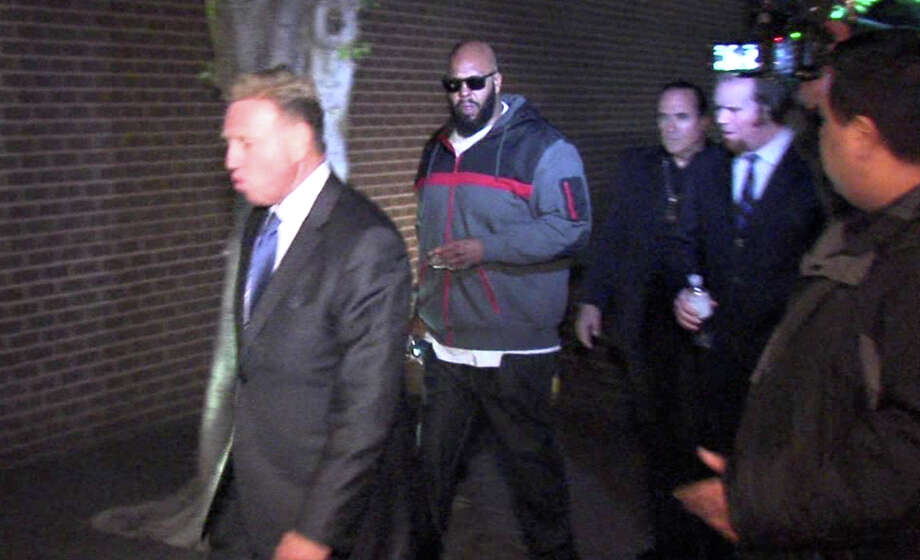 """Marion """"Suge"""" KnightA trial is underway after the Death Row Records' founder was charged with murder and attempted murder.Prosecutors allege that Knight intended to run down his friend and another man on Thursday, Jan. 29 during an argument on a movie set. One of the men died. Knight's attorney, however, says Knight accidentally ran over the man while trying to escape the fight. Photo: TEL / OnSceneVideo via AP Television"""