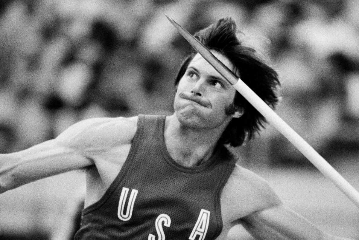FILE - This July 30, 1976 file photo shows decathlon gold medalist Bruce Jenner throwing the javelin during Olympic competition in Montreal.