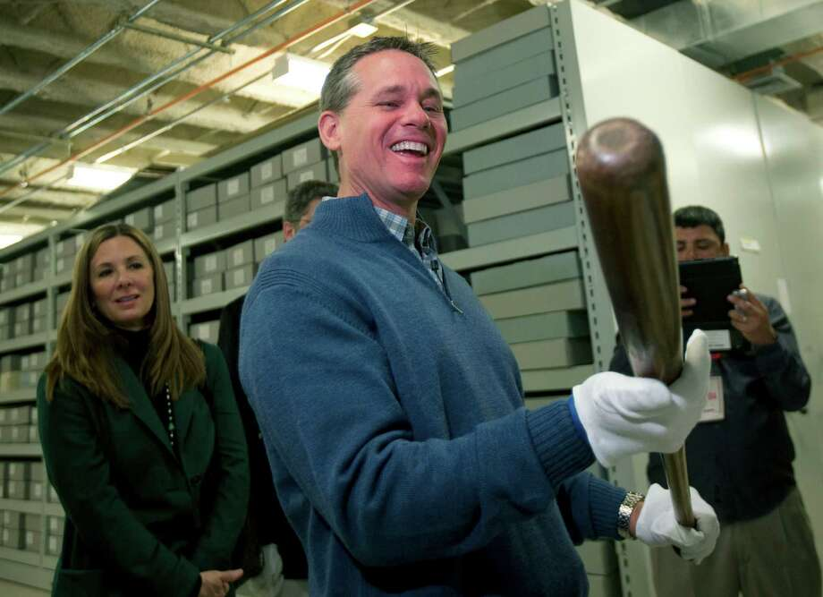 "Craig Biggio was all smiles as he and wife Patty got a tour of baseball's Hall of Fame on Friday in Cooperstown, N.Y. ""No way!"" an excited Biggio said as he picked up ex-Yankee slugger Babe Ruth's bat. Photo: Mike Groll, STF / AP"